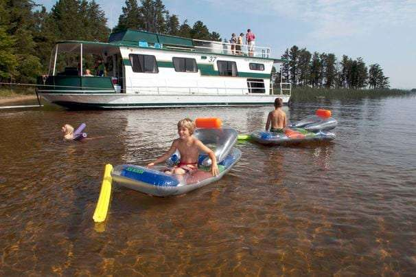 Aboard rented houseboats, vacationers take to the water at a safe distance