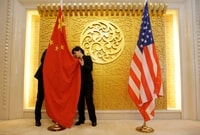 Image: Chinese and U.S. flags are positioned for a meeting between Chinese Transport Minister Li Xiaopeng and U.S. Transportation Secretary Elaine Chao at the Chinese Ministry of Transport in Beijing on April 27, 2018.