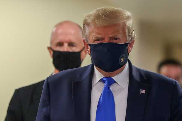 Breaking news! Trump finally puts on a mask!