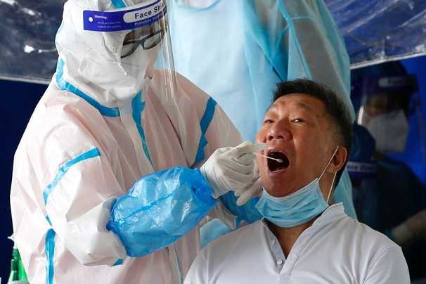 Hong Kong was a pandemic poster child. Now it's a cautionary tale.