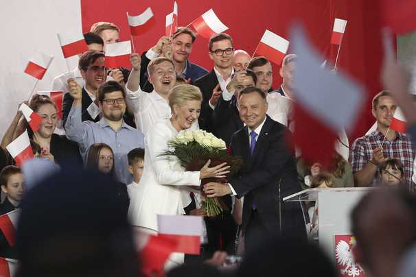 Polish President Duda and challenger Trzaskowski in tight race amid high turnout