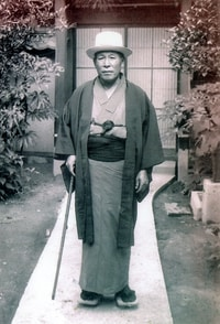 Howard Kakita's paternal grandfather, Yaozo, stands in the courtyard of his home in Hiroshima in 1940. (Family photo)