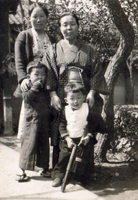 Howard Kakita and his older brother, Kenny, pose with their mother, Tomiko, and paternal grandmother, Matsuko, in Hiroshima. The boys and their parents had sailed from California in early 1940 for an extended visit with relatives. (Family photo)