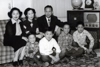 Image: It would take several years after World War II ended for Howard Kakita and his brother, Kenny, to be reunited with their parents and siblings. A 1949 photo in the family's living room in California shows the boys arranged youngest to oldest: Allan, front left, Albert, Howard and Kenny. On the sofa are the boys' aunt, Eiko, left; mother, Tomiko; and father, Frank. (Family photo)