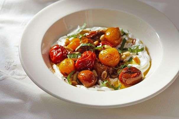 This bowlful of yogurt with roasted cherry tomatoes tastes like a luscious indulgence
