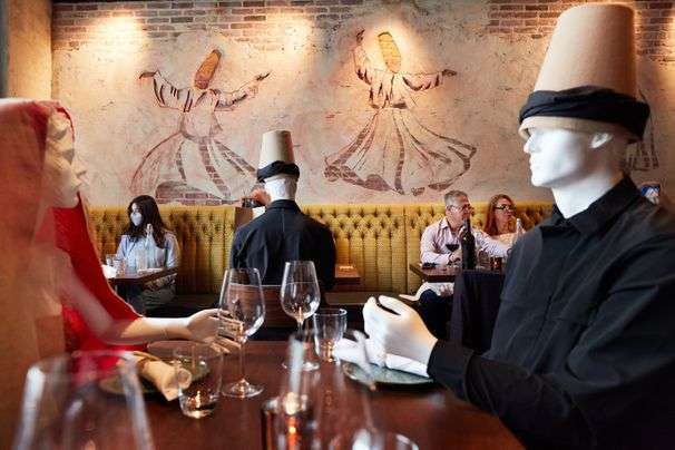 At Rumi's Kitchen, you'll find poetry on the plate and mannequins by your side
