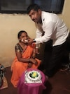 Ganesh Tikone and his wife, Jyoti, celebrate her birthday earlier this year. Ganesh Tikone, 42, died of covid-19 this month.
