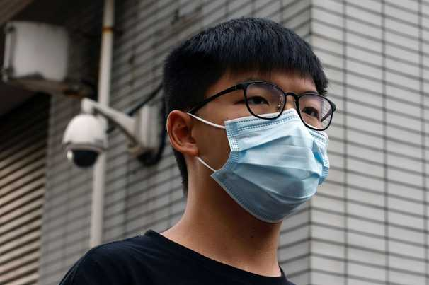 Hong Kong police arrest activist Joshua Wong for wearing a mask as repression deepens