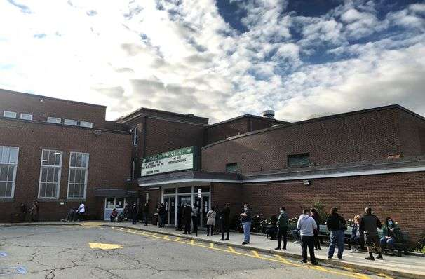 In small-town, suburban New York, hundreds lined up to send an early-voting message