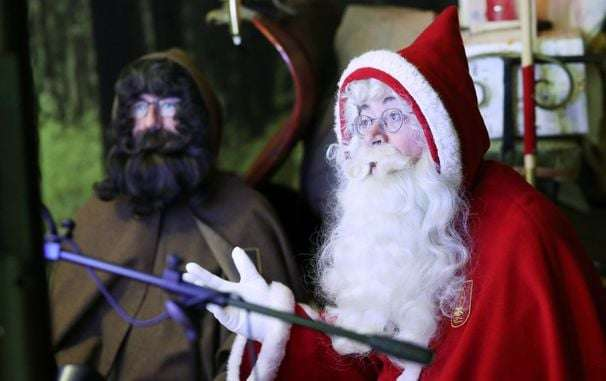 Santa keeps social distancing in mind as he pops up around the world
