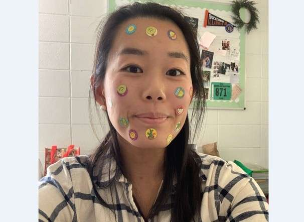 Why are teachers' faces covered in stickers? To get kids engaged in remote school — and it's working.