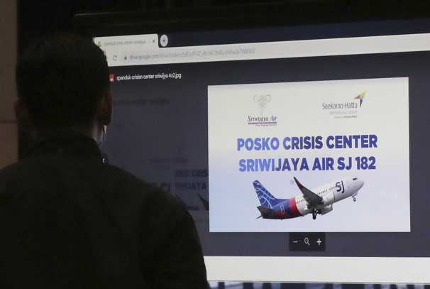 Indonesian plane with 62 aboard is missing; rescue workers recover possible debris