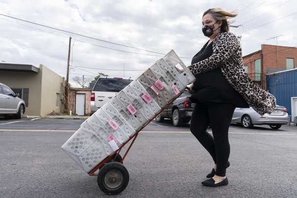 USPS delays are threatening small-town newspapers. So is a postage price increase.