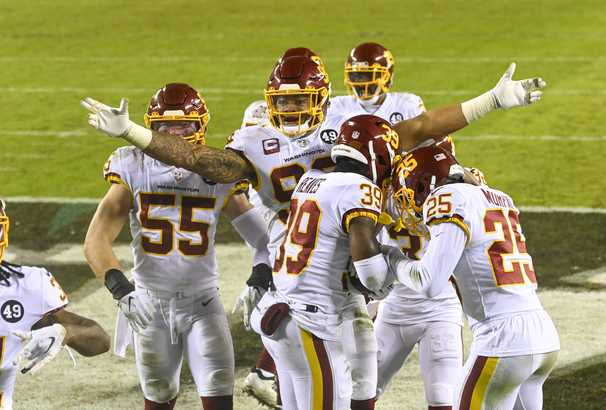 Washington hangs on to beat Eagles, claiming NFC East title and a playoff berth
