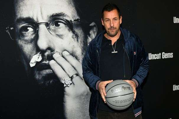 Adam Sandler keeps reminding us that he's just a normal guy