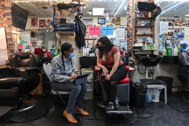 Barbershop offers coronavirus shots, in addition to cuts and shaves. Some see it as a national model.