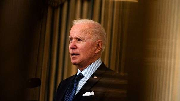 Biden sets new vaccine goals as White House grapples with its message
