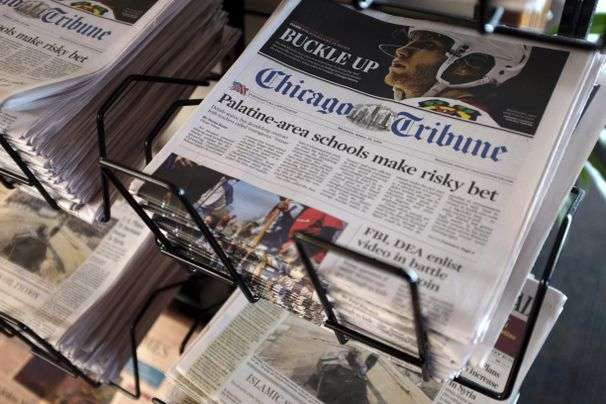 Tribune shareholders vote to sell legendary chain of newspapers to a hedge fund