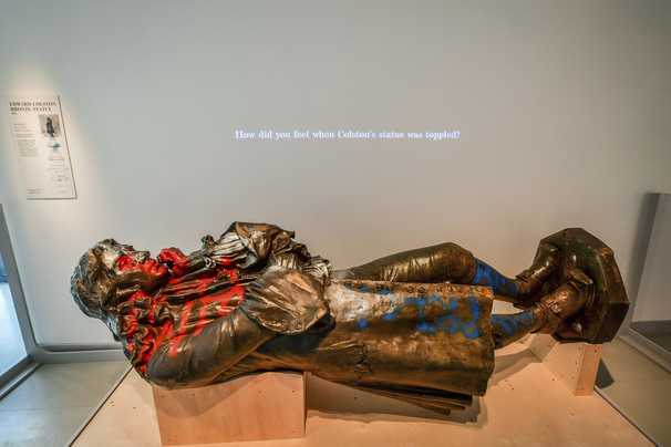 A British museum is asking visitors what to do with toppled statue of trader who enslaved people