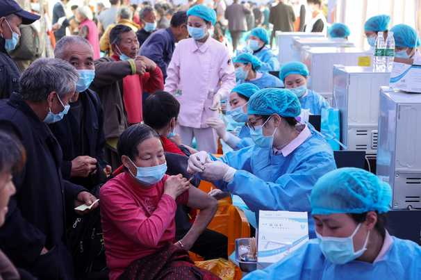 Covid-19 live updates: China passes 1 billion vaccinations amid tightened curbs, questions on shots' efficacy