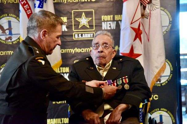 Racism kept a Black WWII vet from a Purple Heart, he says. At 99, he got the award.