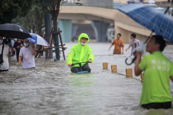 Rescue efforts launched after record floods in central China displace 1.2 million