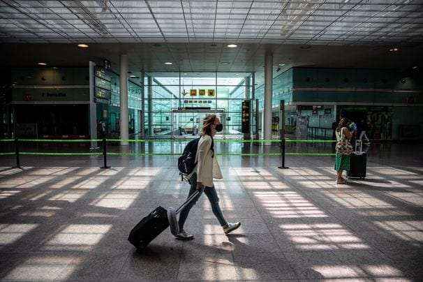 Should you cancel travel plans because of the coronavirus's delta variant? Ask these questions.