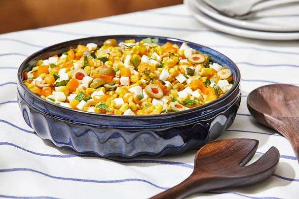 This summer corn salad gets dressed up with halloumi, peppers and olives