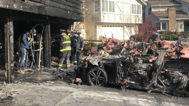 While they were asleep, their Teslas burned in the garage. It's a risk many automakers are taking seriously.