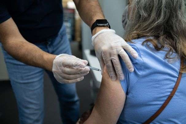 Can you get a covid booster and a flu shot together? Here's what you need to know.