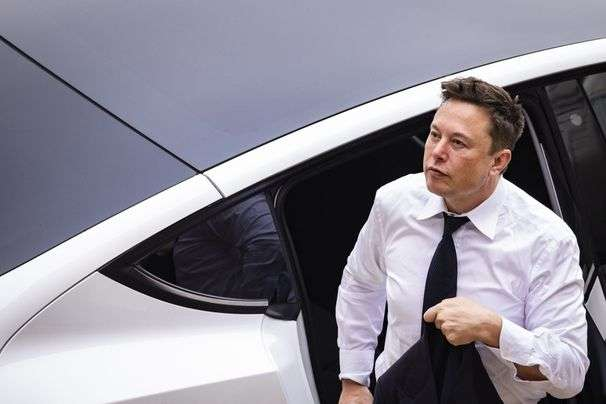 The government helped Tesla conquer electric cars. Now it's helping Detroit, and Elon Musk isn't happy.