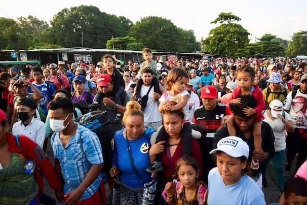 Tired of waiting for asylum in southern Mexico, thousands of migrants march north